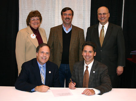 Bluefield College and Leland Seminary sign a transfer agreement.